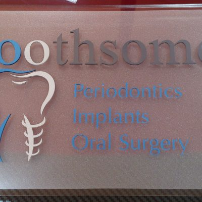 Image of Toothsome custom wall-mounted signage by Image Plastics