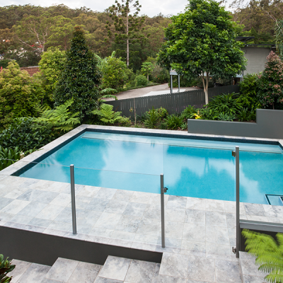 Stock image of a pool with clear fencing